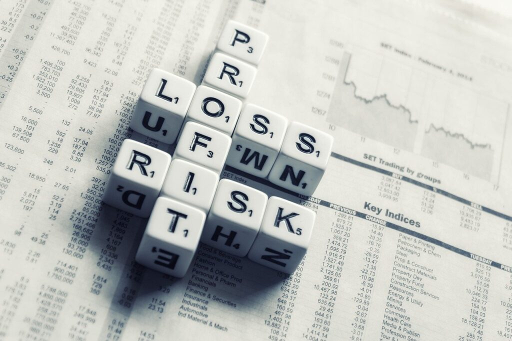 dices over newspaper, profit, loss risk